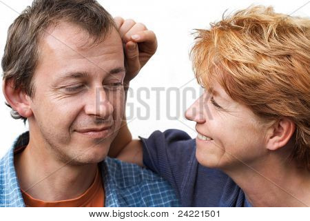 Middle-age couple joking, he is looking foolish