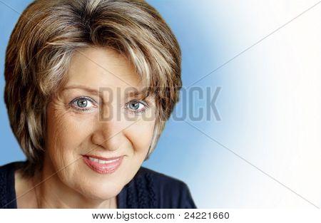 Senior woman portrait on blue white background