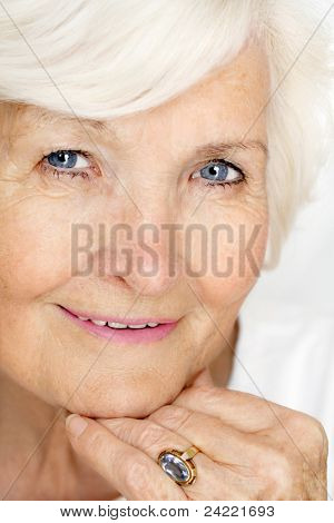 Beautiful senior lady portrait with hand on chin