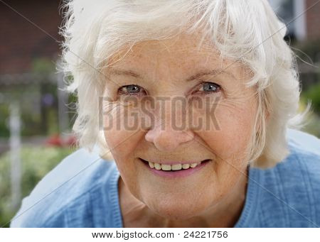 Natural senior woman portrait, outdoor
