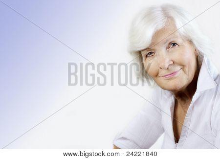 Gracious senior woman portrait with copy-space