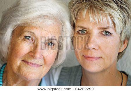 Senior woman and mature daughter portrait