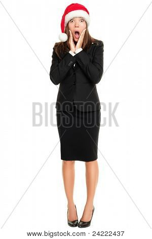 Christmas business woman in santa hat and business suit excited and cheerful screaming of joy standing in full body isolated on white background. Asian Caucasian female model
