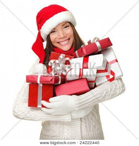 Mulher compra de Natal com muitos presentes de Natal em sua armas vestindo pano de chapéu e Inverno de santa