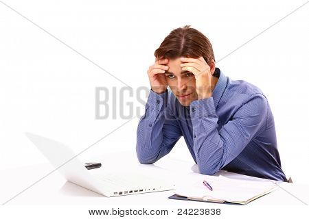 Overworked young man in front of laptop isolated