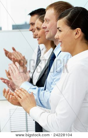 Row of clapping business people