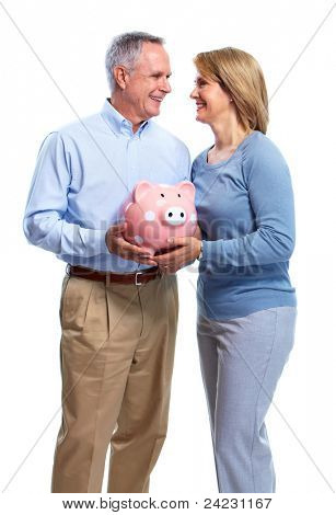Happy senior couple with piggy bank. Isolated over white background.