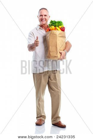 Senior smiling man with grocery items . Isolated over white background.
