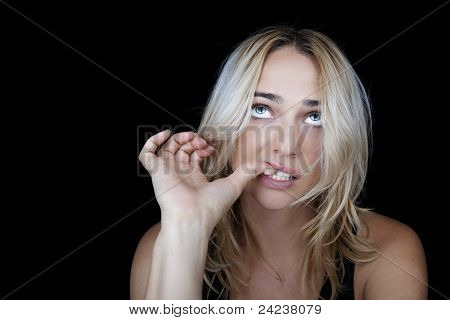 Nervous woman biting her nails.