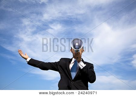 Businessman holding megaphone and cloud background