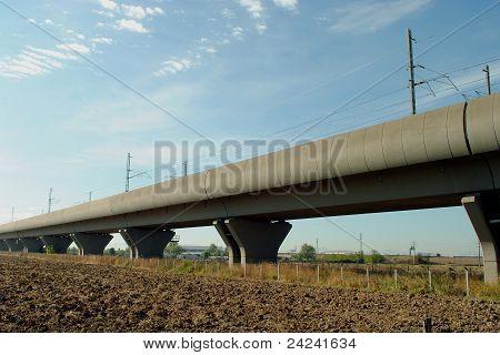 high speed train elevated railway in farmlands