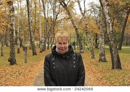 Middle-aged Woman In Autumn Park