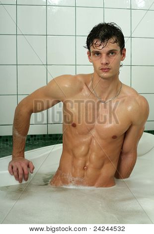 Young Sexy Man Taking Bath