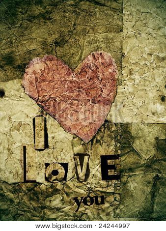 i love you written with with newspaper clippings in a old paper background with a heart