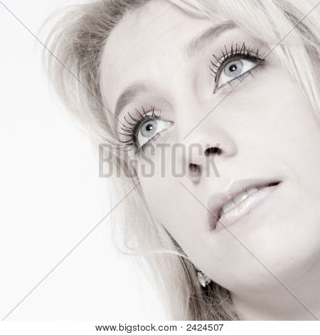 Studio Portrait Of A Long Blond Girl Looking Up