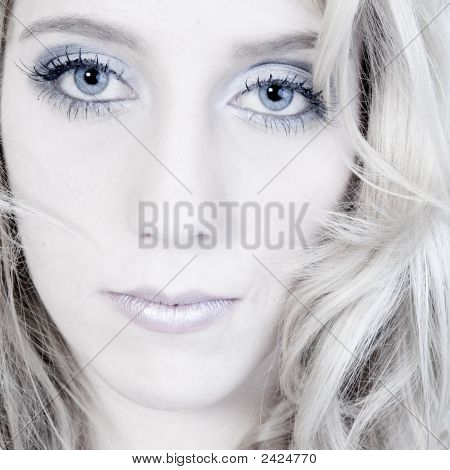 Studio Portrait Of A Long Blond Girl Looking Hurt