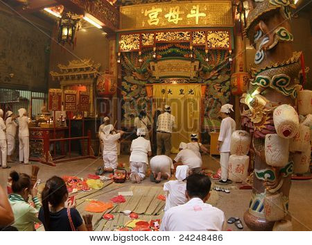 AMPANG, MALAYSIA â?? OCT 05: Taoist devotees chant, meditate and pray at the main hall of the Lam Thian Kiong Temple at the annual â??Nine Emperor Godsâ?? Festival on October 05, 2011 in Ampang, Malaysia.