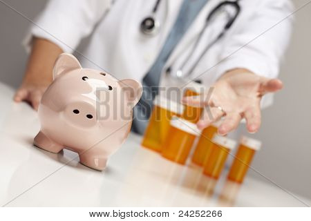 Doctor Wearing Stethoscope Reaches Palm Out Behind Medicine Bottles and Piggy Bank.