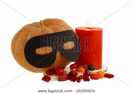 Halloween Candies With Candle And Masqueraded Pumpkin Isolated