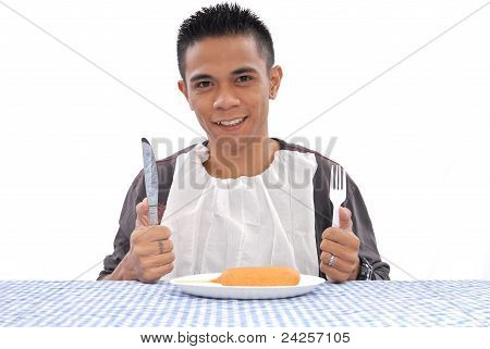 Man Getting Ready To Eat A Corn Dog