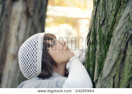 Fashion girl portrait in a hat and gloves, outdoor.