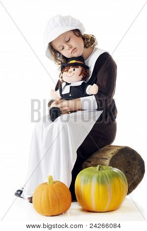 Sleepy Pilgrim With Her Dolly
