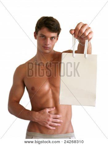 Muscular Man Holding Shopping Bag