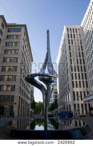 Spring Sculpture Between Skyscrapers