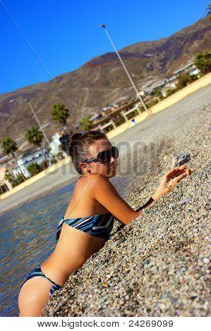 The girl sunbathing on a beach