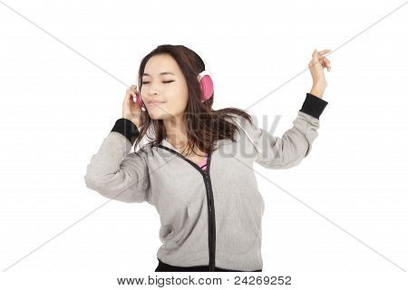 asian young woman listening to music and dancing