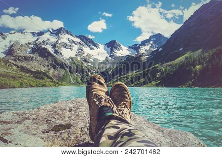 poster of Feet Selfie Traveler Relaxing With Lake And Mountains View On Background Lifestyle Hiking Travel Con