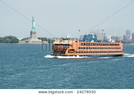NEW YORK - AUG 03: Staten Island Ferry cruises past the Statue of Liberty on August 3, 2011 in New York.  The Ferry provides transportation to 20 million people a year and is free of charge.