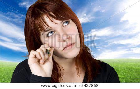 Cute Redhead In Dilemma