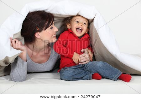 Woman playing a hiding game with her child