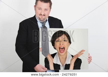Businessman with a picture of a woman shouting
