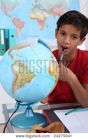 Little boy in classroom, looking bored