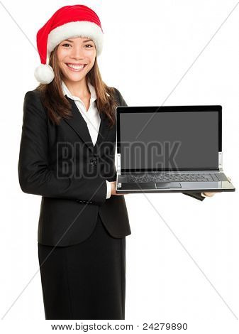 Christmas business woman holding computer laptop in santa hat. Businesswoman showing notebook PC screen with copy space for advertisement. Asian Caucasian female model isolated on white background.