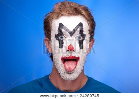 A man with clown makeup on his face