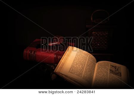 books pipe and night lamp