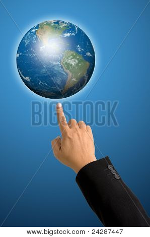Index Finger In Black Suit Pointing Up To The Globe