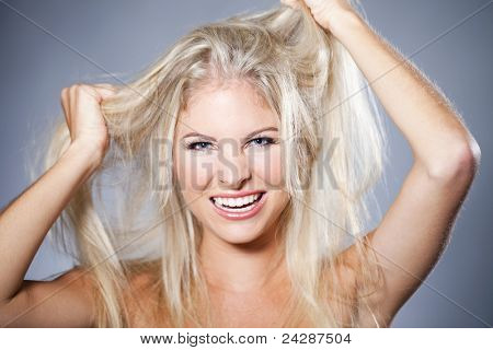 Beautiful woman having a bad hair day