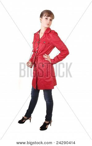 Teenager In Red Coat.