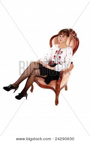 Beautiful Girl In Armchair.