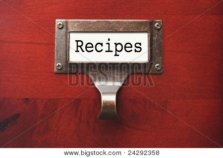 Lustrous Wooden Cabinet with Recipes File Label in Dramatic LIght.