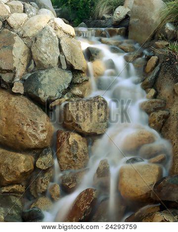 Water cascades over rocks