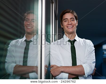 Businessman With Arms Crossed Smiling At Camera