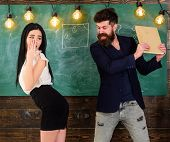 Man With Beard Slapping Sexy Student, Chalkboard On Background. Schoolmaster Punishes Sexy Student W poster