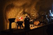 stock photo of witchcraft  - An old alchemist laboratory interior, low light