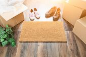 Home Sweet Home Welcome Mat, Moving Boxes, Women and Male Shoes and Plant on Hard Wood Floors. poster