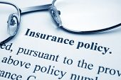 picture of policy  - Close up of glasses on Insurance policy